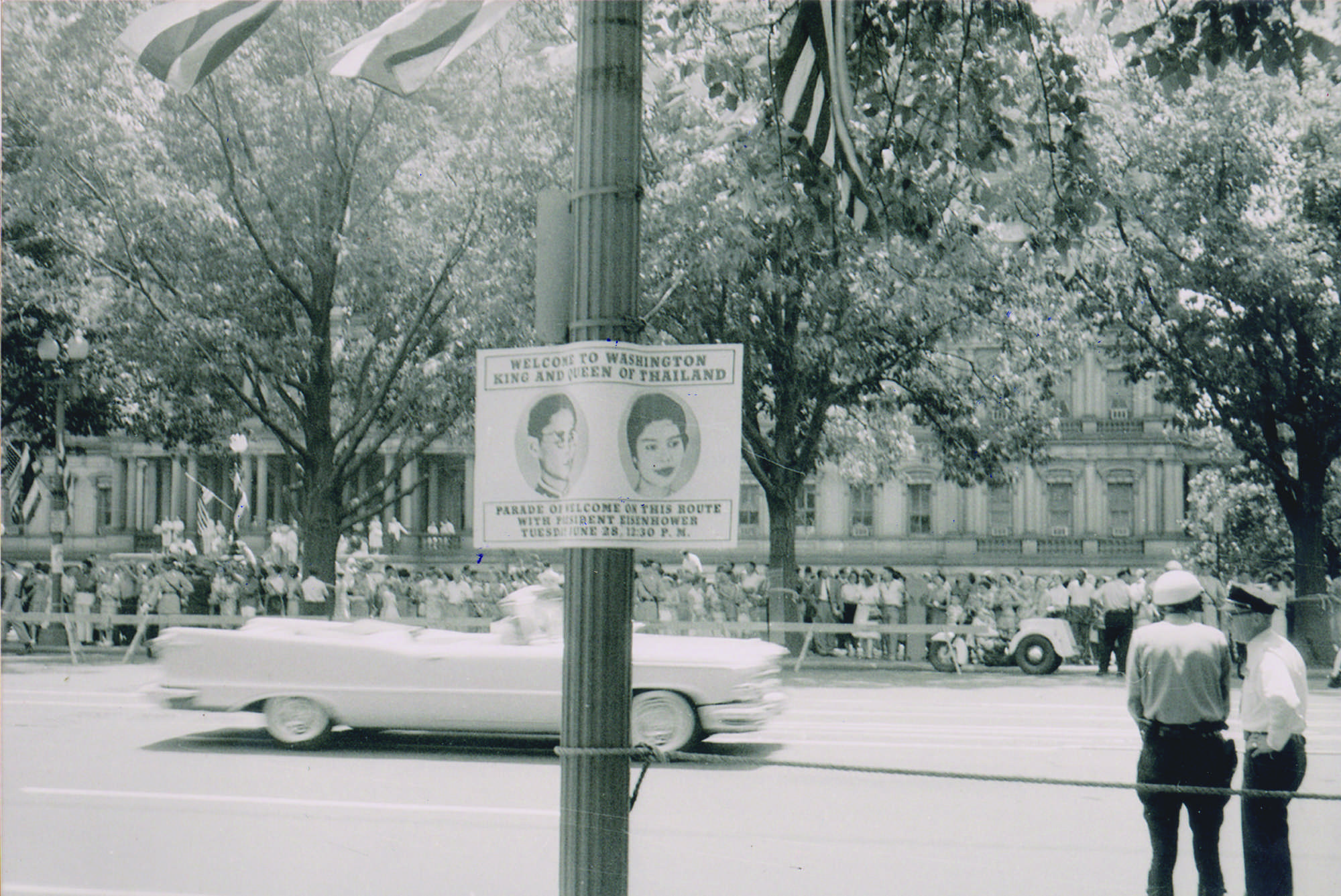Images of Their Majesties posted on roadside